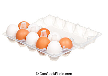Eggs in box - Brown and white eggs in the plastic box over...