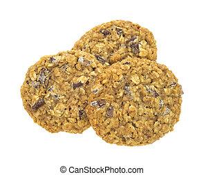 Three granola cookies on white background
