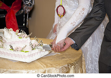 Wedding pie - The wedding pie is cut by the groom and the...