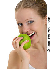attractive healthy girl biting an apple isolated