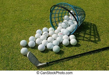 Basket of Driving Range Golf Balls - Golf balls pouring out...