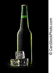 Bottle of beer with ice cubes