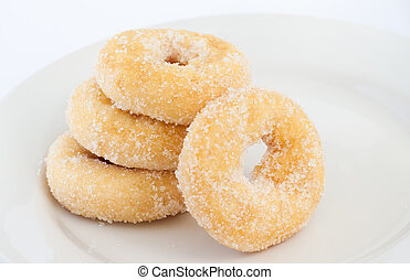Donut on white plate - 4 donuts on white plate