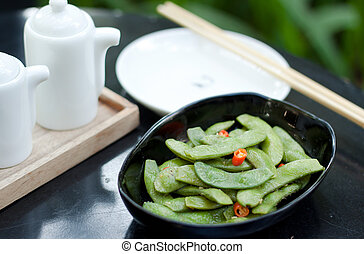 Green beans with red chilli in black bowl - green beans with...