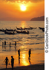 Long tailed boat at sunset in Thailand