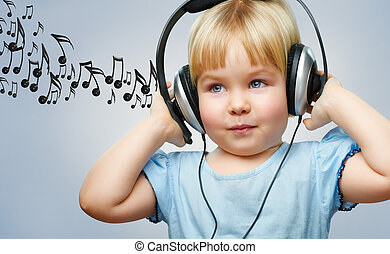 girl with headphones - a little girl listening to music