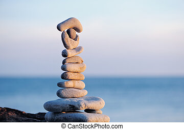 Stacked Stones - Pile of pebbles each other on a sea boulder...