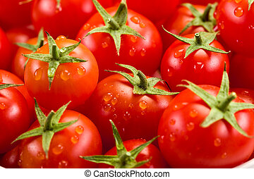 Tomato background - photo of very fresh tomatoes presented...