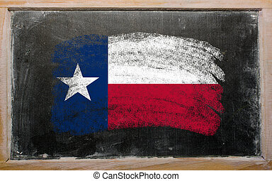flag of US state of texas on blackboard painted with chalk -...