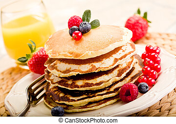 Pancakes - delicious pancakes on morning breakfast table...