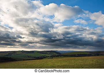 Stunning cloud formations during stormy sky over countryside landscape with vibrant colors