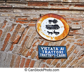 old signs - old Italian signs on a brick wall