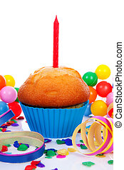Birthday cupcake with candle streamers and colorful confetti