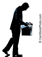 silhouette man fired carrying heavy box - one caucasian man...