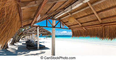 shelter on beach - shelter made of natural materials on a...