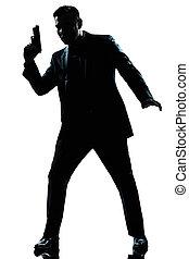 silueta, homem, espião, segurando, arma