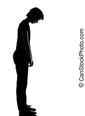one young teenager boy or girl sad looking down silhouette