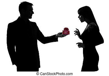 one caucasian couple man kneeling offering present gift and woman surprised in studio silhouette isolated on white background