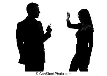 one couple man smoking cigarette and woman disturbed - one...