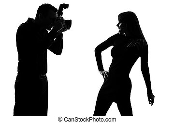 one couple man photographer and woman fashion model - one...