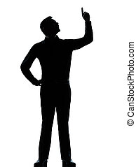 one business man poiting up happy silhouette - one caucasian...