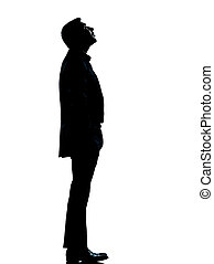 one business man silhouette looking up - one caucasian...