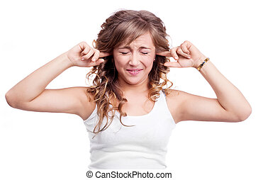 woman closing ears - portrait of an angry young woman...