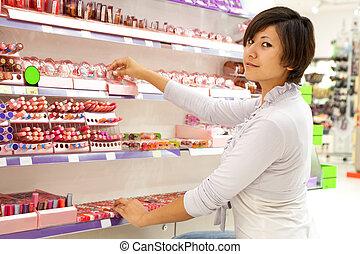woman   at cosmetics  shop
