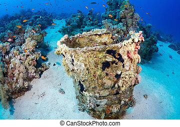 Barrel of oil underwater
