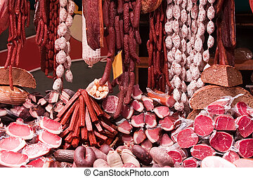 Meat and sausages in market - Meat and sausages on...