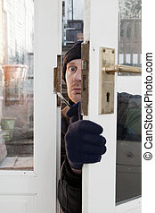 Theif breaking-in burglary security - Breaking and entering...
