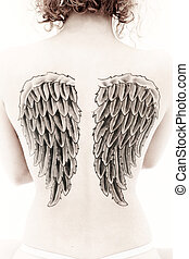 Sepia Woman Back Wing Tattoo - Sepia image of woman's back...