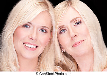 mother and daughter- natural beauty concept, over black