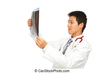 Young  doctor checking x-ray carefully
