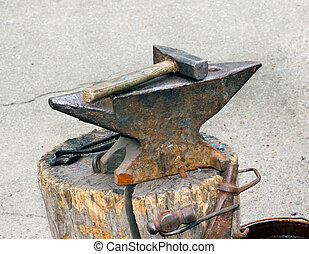 Hammer and anvil   - Hammer and anvil used by a blacksmith.