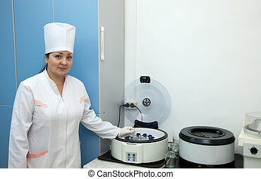 Doctor working with blood centrifuge - Doctor working with...