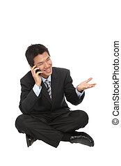 Young business man  speaking with cell phone