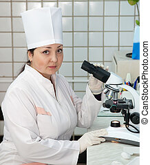 doctor with microscope in lab