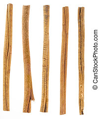 five cinnamon sticks isolated on white. High angled cinnamon...