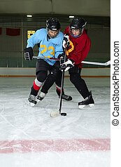 Hockey Player Scrimmage in Rink - Two Boys play a Winter...
