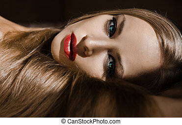 Face of attractive girl with long blonde hair and red lips...