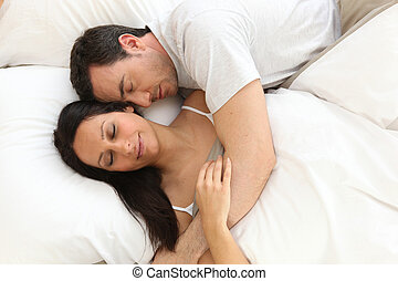 Couple in bed asleep