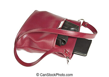 Personal Weapon - Personal weapon in red purse on white...