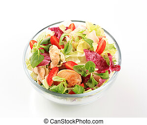 Chicken salad - Bowl of greens with pieces of chicken meat