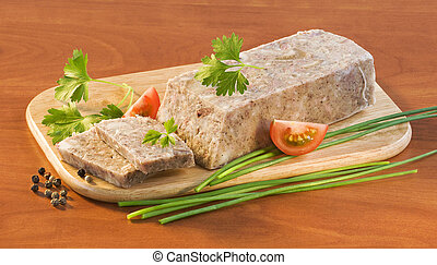 Pork brawn terrine on a wooden cutting board