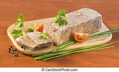 Pork brawn terrine on a wooden cutting board