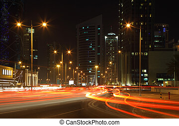 Traffic at night in Doha downtown, Qatar