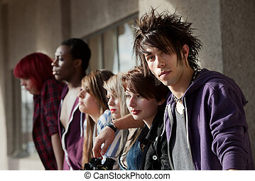 Young Punk Stares - Young punk boy looks at the camera as...
