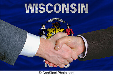 in front of american state flag of wisconsin two businessmen...