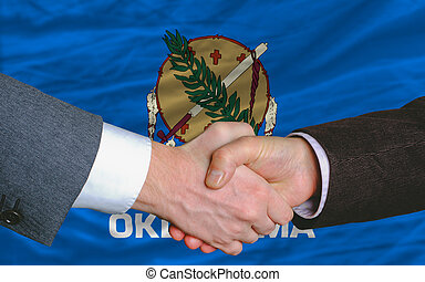 two businessmen shaking hands after good business investment...